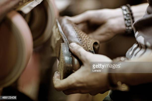 shoemaker working on shoe