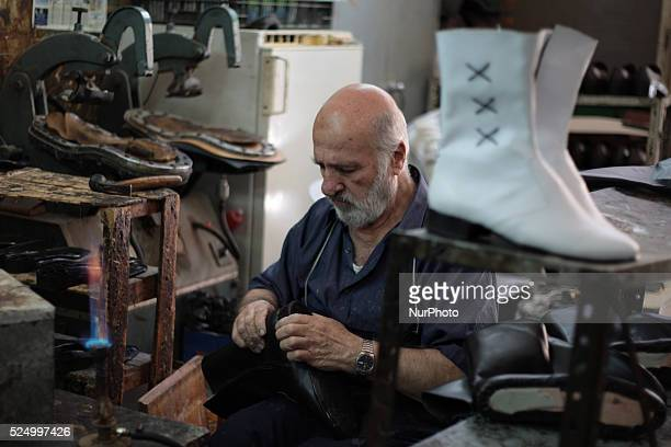 Shoemaker works in a shoemaking workshop manually in old town of Nablus city West Bank on May 31 2015 Nablus city northern of the Palestinian...