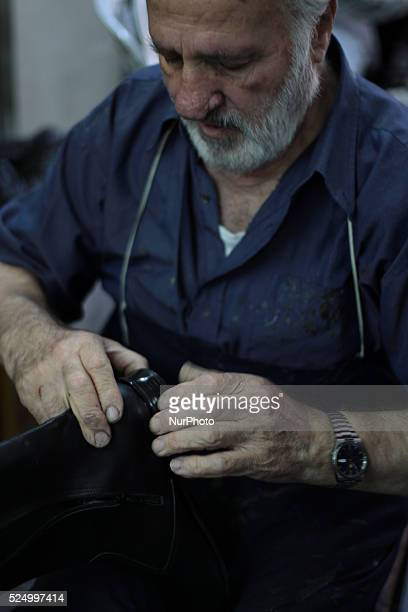 Shoemaker works in a shoemaking workshop manually Old town of Nablus city West Bank on May 31 2015 Nablus city northern of the Palestinian...