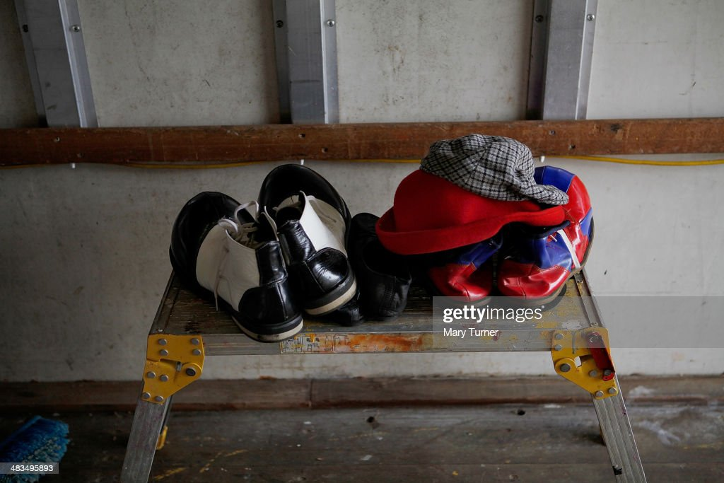 Shoes and hats for Mr Fips the Clown sit on a table, waiting to be used by circus owner Jan Erik Brenner in his role as Mr Fips on April 7, 2014 in Huntingdon, England. Mr Fips Wonder Circus is a small, family run circus, who during their latest season will travel up the east of England until their season draws to a close in November. They are a company of around 20 performers, all family and friends from the circus community and their youngest member is 12 years old and their oldest is 75 years old. The troupe formed three years ago when Jan Erik Brenner and his wife Carolyn decided that they wanted to return the circus to the intimacy and magic of their childhood memories, and now play to audiences of between 100 and 500 adults and children.