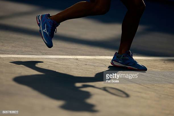 Shoes and shadow of Yulia Putintseva of Kazakhstan as she serves in her second round match against Xinyun Han of China during day three of the 2016...
