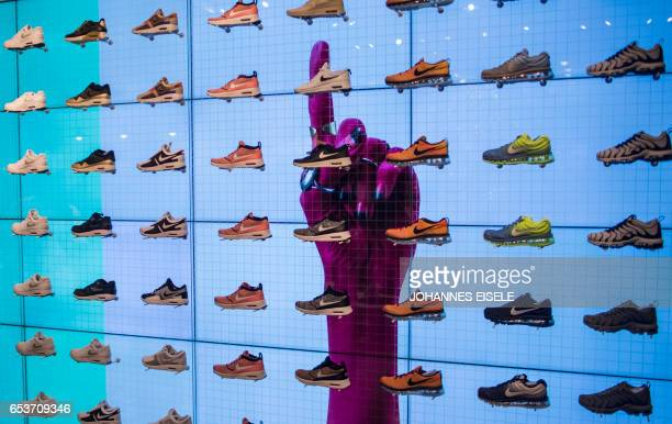 Shoes are displayed for sale inside the flagship store of sportinggoods giant Nike in Shanghai on March 16 2017 US sportinggoods giant Nike has...