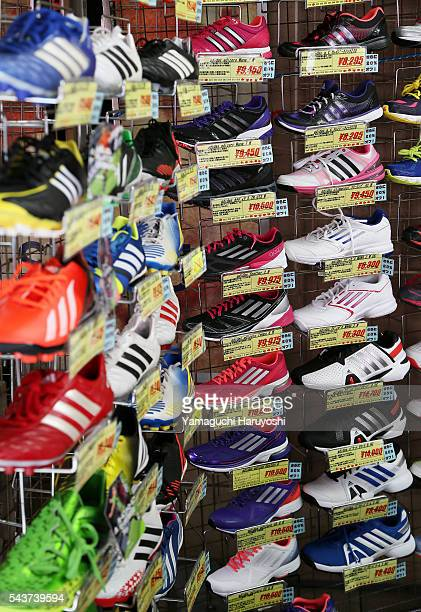Shoes are displayed in a shoe store at Ameyoko market in Tokyo Japan Sep 2013 Ameyoko is a bustling outdoor marketplace and Tokyo's most busiest...