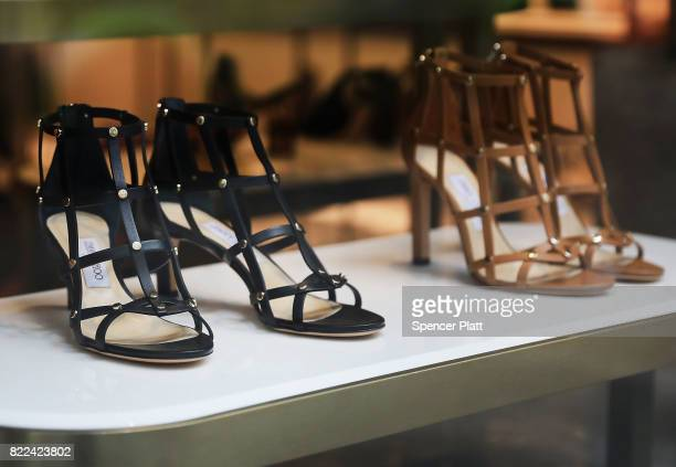Shoes are displayed in the window of a Jimmy Choo store in lower Manhattan on July 25 2017 in New York City Michael Kors Holdings announced on...