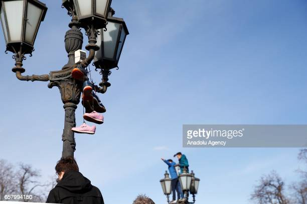 Shoes are hung on a lamppost during an opposition rally on March 26 2017 in Moscow