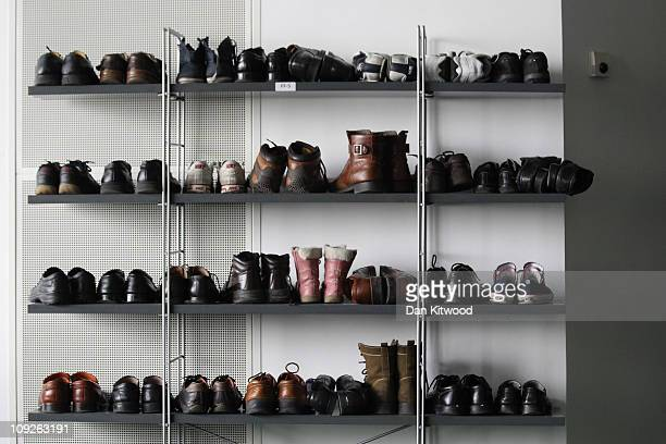 Shoes are left on shelves while Muslim men pray at Baitul Futuh Mosque in Morden on February 18 2011 in London England Around five thousand Muslim...