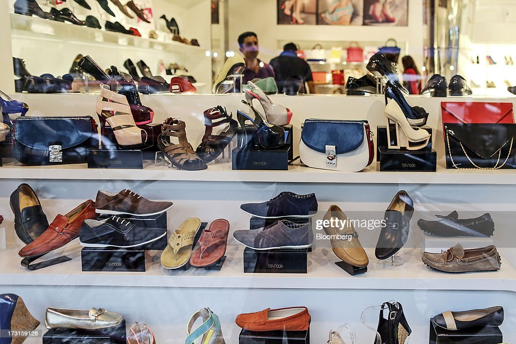 Shoes are on displayed for sale at a Tresmode footwear store in the suburb of Bandra in Mumbai, India, on Saturday, July 6, 2013. India's consumer price index (CPI) figures for June are scheduled to be released on July 12. Photographer: Dhiraj Singh/Bloomberg via Getty Images