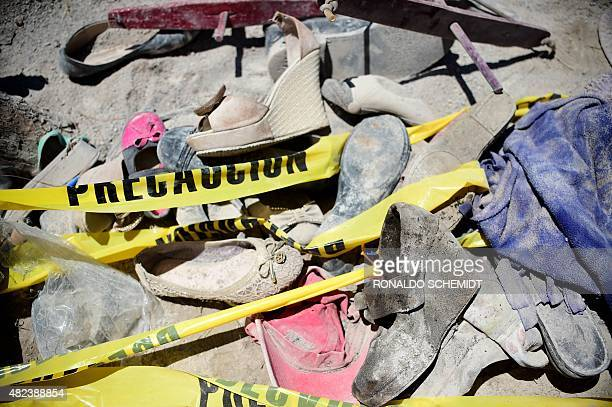 Shoes are pictured on July 30 in the site where a truck plowed into a crowd of pilgrims on the eve after apparently losing its brakes in Mazapil...