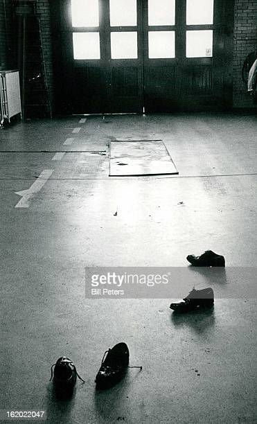 1974 JAN 31 1974 Shoes ***** behind when Denver firemen jump in their rubber hip boots exemplify the haste required when answering fire alarms...