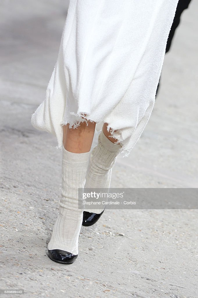 Shoes carried by a model as she walks during Chanel show, as part of the Paris Fashion Week Womenswear Spring/Summer 2014, in Paris.