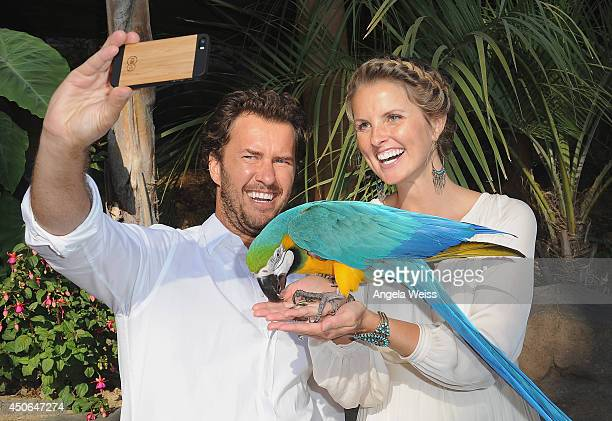 Shoes founder and Chief Shoe Giver Blake Mycoskie and TOMS Shoes Chief Animal Lover Heather Mycoskie take a 'selfie' at the Greater Los Angeles Zoo...