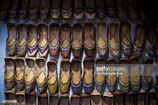 Shoes hang for sale in a shop on Shahid Bhagat Singh Road also known as the Colaba Causeway where many local and foreign goods can be found for sale...