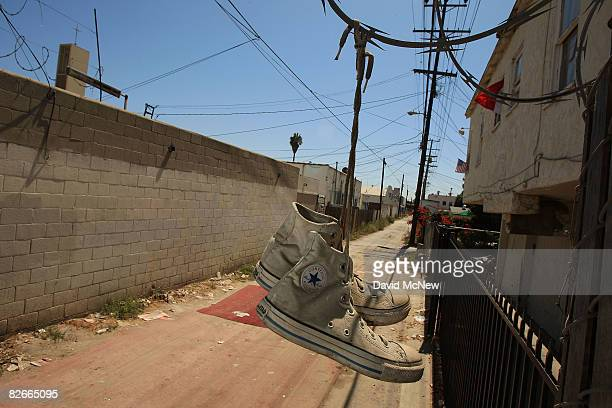 Shoes hang from concertina wire in an alley that runs along Western Avenue an area where an elusive serial killer has been dumping bodies since 1985...