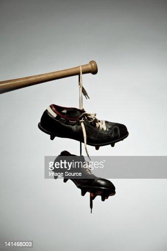 Shoes hanging from baseball bat