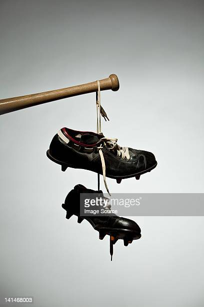Shoes hanging from baseball bat