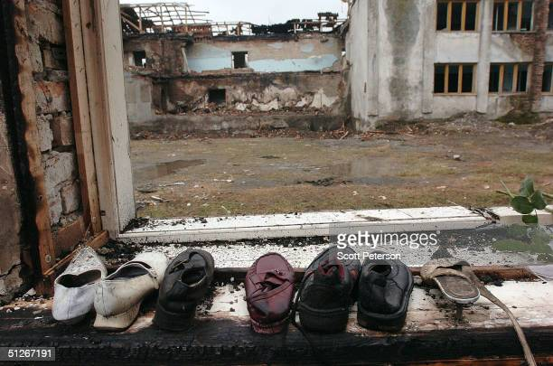 Shoes lay lined up on the ground of a school September 6 2004 in Beslan southern Russia More than 350 people died after Chechen militant...
