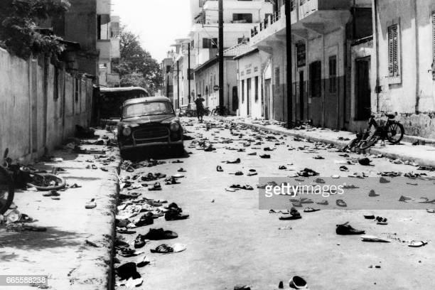 Shoes lay on the street following clashes between police against students and workers during a demonstration in Dakar on May 31 1968 / AFP PHOTO /