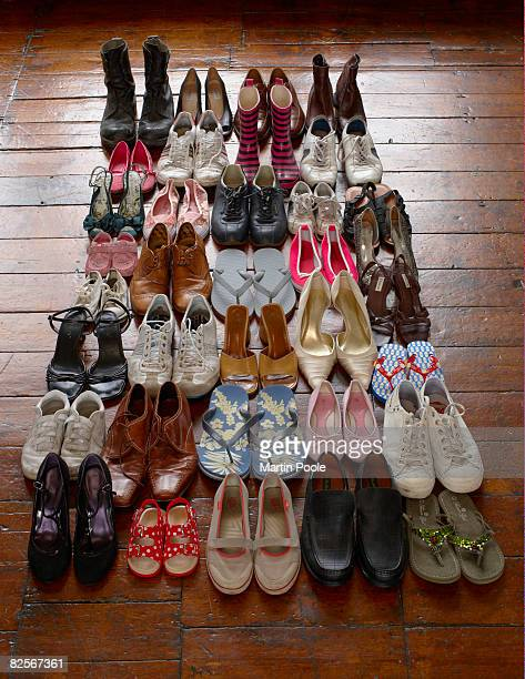 shoes neatly organised on wooden floor