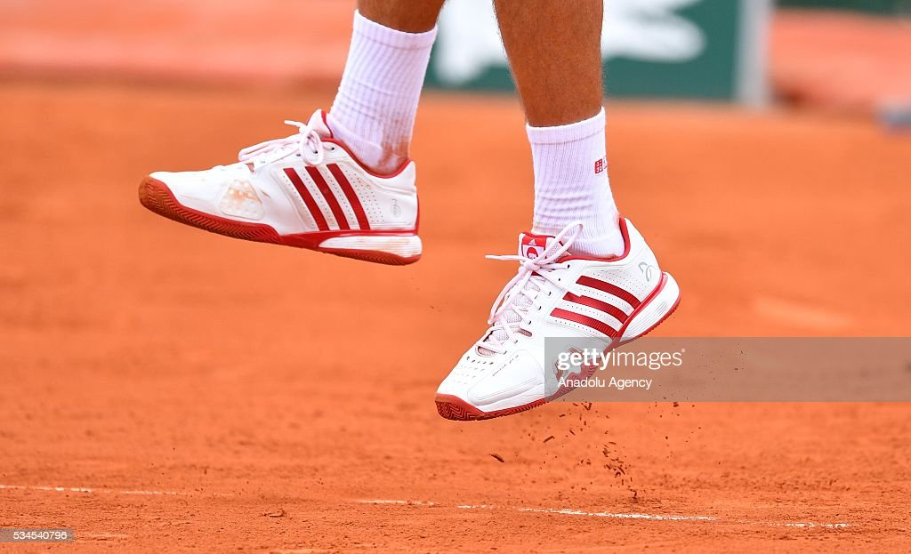 Shoes of Novak Djokovic is seen as he plays against Steve Darcis (not seen) of Belgium during their men's single second round match at the French Open tennis tournament at Roland Garros in Paris, France on May 26, 2016.