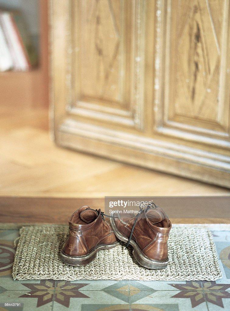 Shoes on doormat