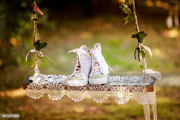 Shoes On Swing At Wedding