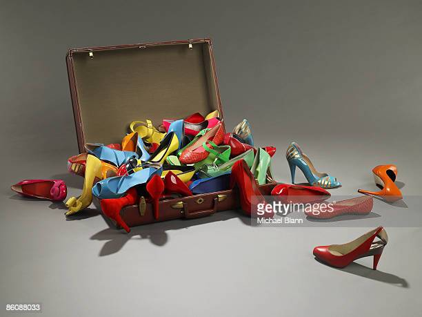 Shoes overflow from suitcase