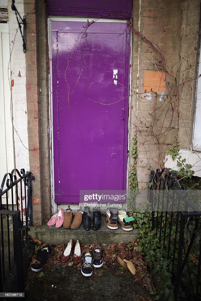 Shoes placed as an artistic installation by a local resident stand on the step of a derelict homes in Cairns Road, Liverpool, one of the locations in the 'Granby Triangle' on February 21, 2013 in Liverpool, England. Liverpool Council are proposing to sell off a selection of it's derelict housing stock for one GB Pound each in the failed redevelopment area known as the Granby Triangle.