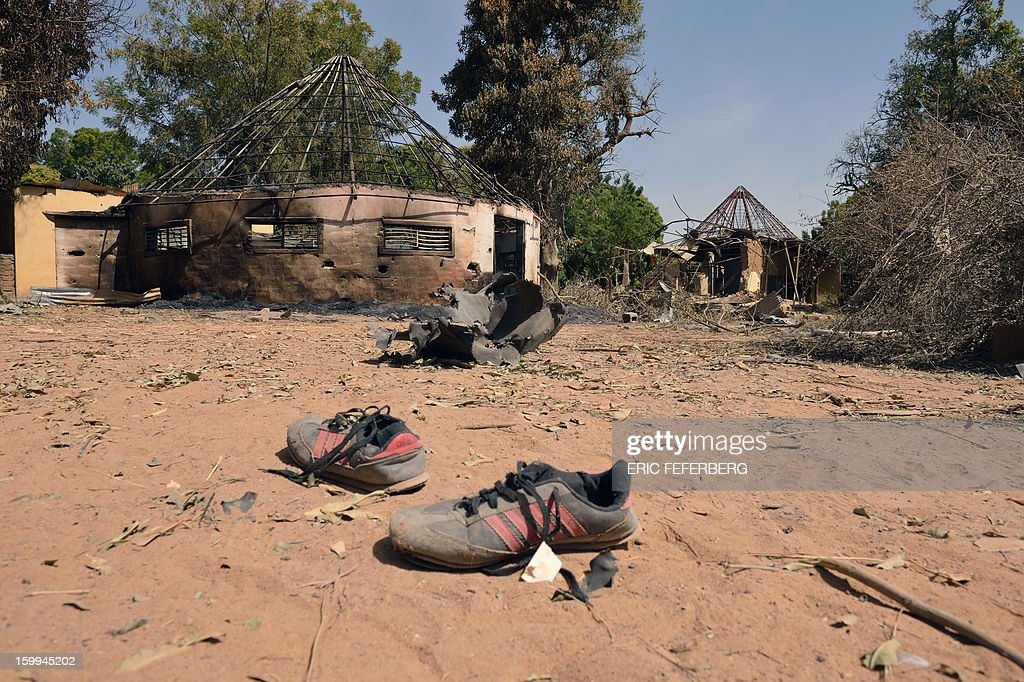 Shoes remain on January 23, 2013 in the Malien barracks that was occupied by Islamists in Diabaly (400km north of Bamako) before a French air strike destroyed it . French soldiers destroyed the munitions that belonged to Islamists to secure the town.