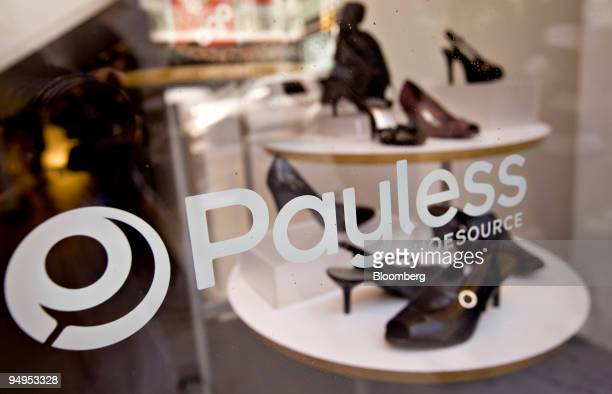 Shoes sit on display in the window of a Payless ShoeSource store in New York US on Wednesday Sept 2 2009 Collective Brands Inc owner of Payless...