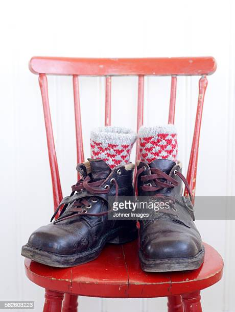 Shoes with socks on chair