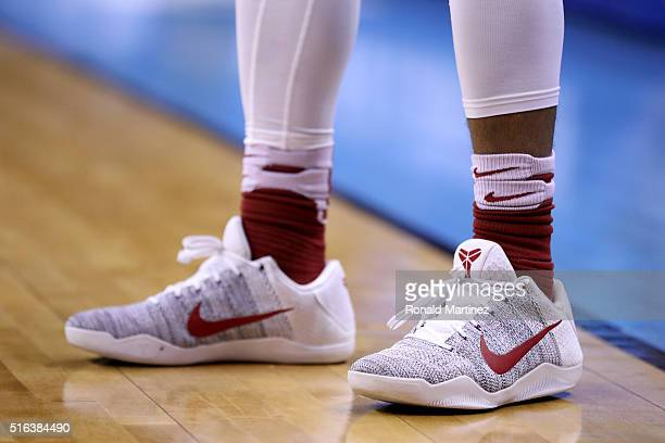 NIKE shoes worn by an Oklahoma Sooners player are seen in the first round of the 2016 NCAA Men's Basketball Tournament at Chesapeake Energy Arena on...