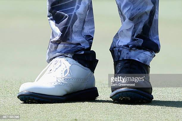 Shoes worn by Danny Lee of New Zealand are seen as he walks the first hole during the third round of the Arnold Palmer Invitational Presented By...