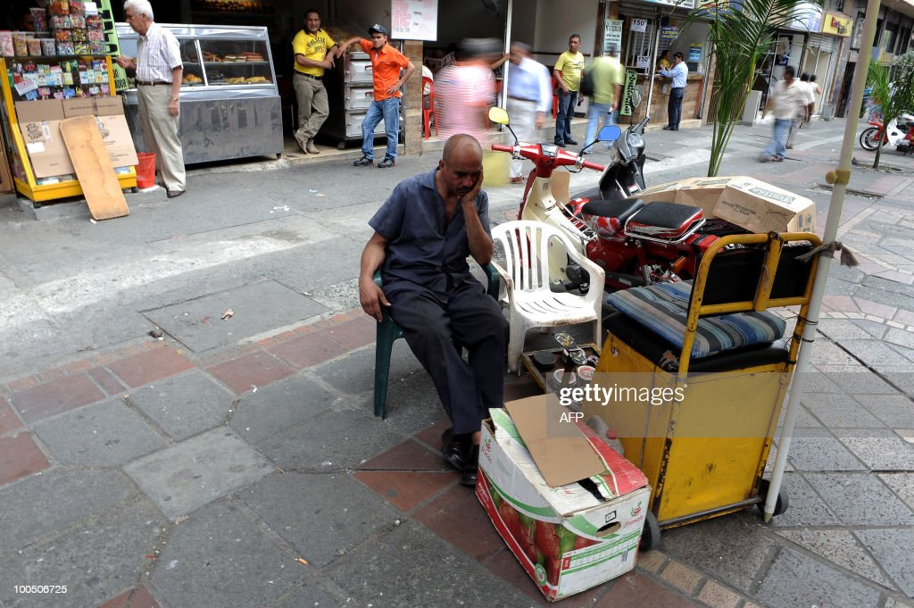 A shoeshiner awaits for customers on May 25, 2010 in Cali, Colombia.