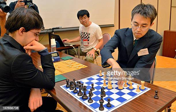 Shogi or Japanese chess champion Yoshiharu Habu and French chess grandmaster Maxime VachierLagrave play shogi and chess at the same time as a part of...