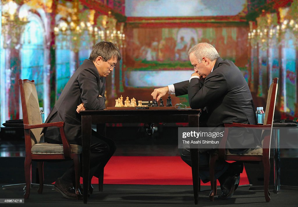 Shogi (Japanese chess) player <a gi-track='captionPersonalityLinkClicked' href=/galleries/search?phrase=Yoshiharu+Habu&family=editorial&specificpeople=5967575 ng-click='$event.stopPropagation()'>Yoshiharu Habu</a> (L) and former chess world champion <a gi-track='captionPersonalityLinkClicked' href=/galleries/search?phrase=Garry+Kasparov&family=editorial&specificpeople=171112 ng-click='$event.stopPropagation()'>Garry Kasparov</a> (R) play chess during an exhibition match at nicofarre on November 28, 2014 in Tokyo, Japan.