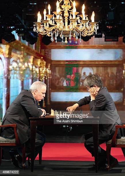 Shogi player Yoshiharu Habu and former chess world champion Garry Kasparov play chess during an exhibition match at nicofarre on November 28 2014 in...