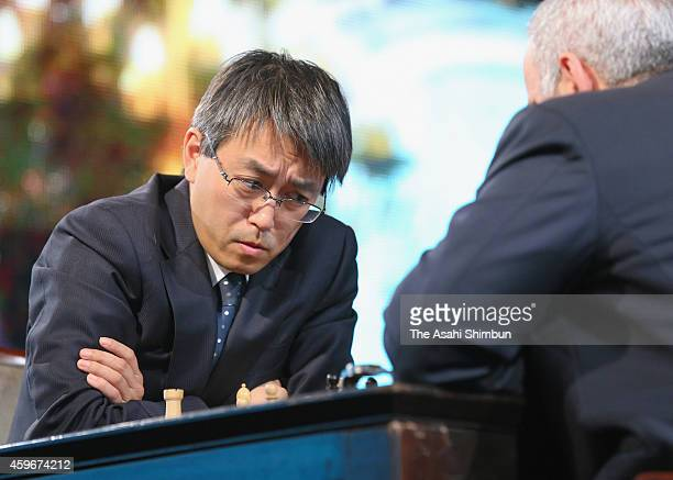 Shogi player Yoshiharu Habu challenges former chess world champion Garry Kasparov during an exhibition match at nicofarre on November 28 2014 in...