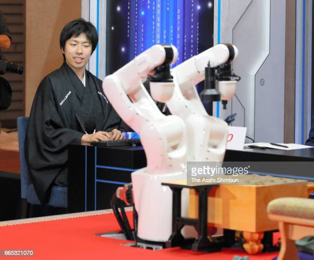 Shogi software 'Ponanza' and its developper Issei Yamamoto are seen after the win over professional shogi player Amahiko Sato in the first round of...