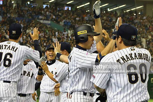 Shogo Akiyama of Japan celebrates with the team after hitting a gameending home run in the bottom half of the seventh inning during the WBSC Premier...