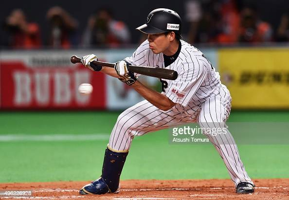 Shogo Akiyama of Japan hits a sacrifice bunt in the bottom of the fourth inning during the WBSC Premier 12 match between Japan and South Korea at the...