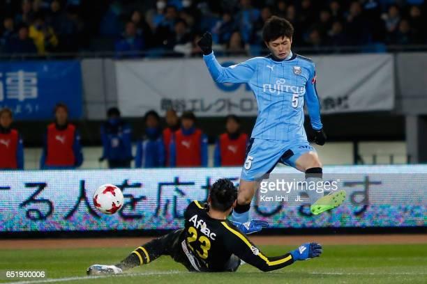 Shogo Taniguchi of Kawasaki Frontale and Kosuke Nakamura compete for the ball during the JLeague J1 match between Kawasaki Frontale and Kashiwa...