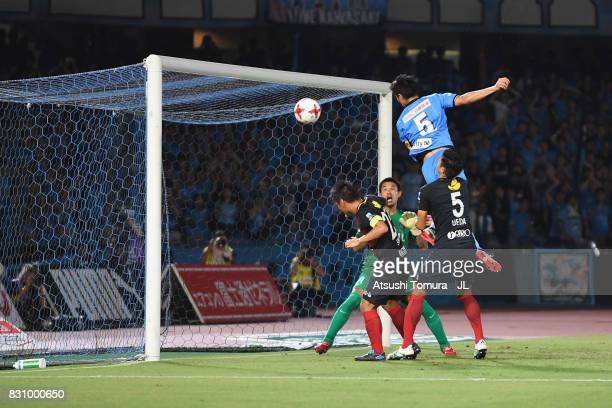 Shogo Taniguchi of Kawasaki Frontale and Naomichi Ueda of Kashima Antlers compete the ball during the JLeague J1 match between Kawasaki Frontale and...