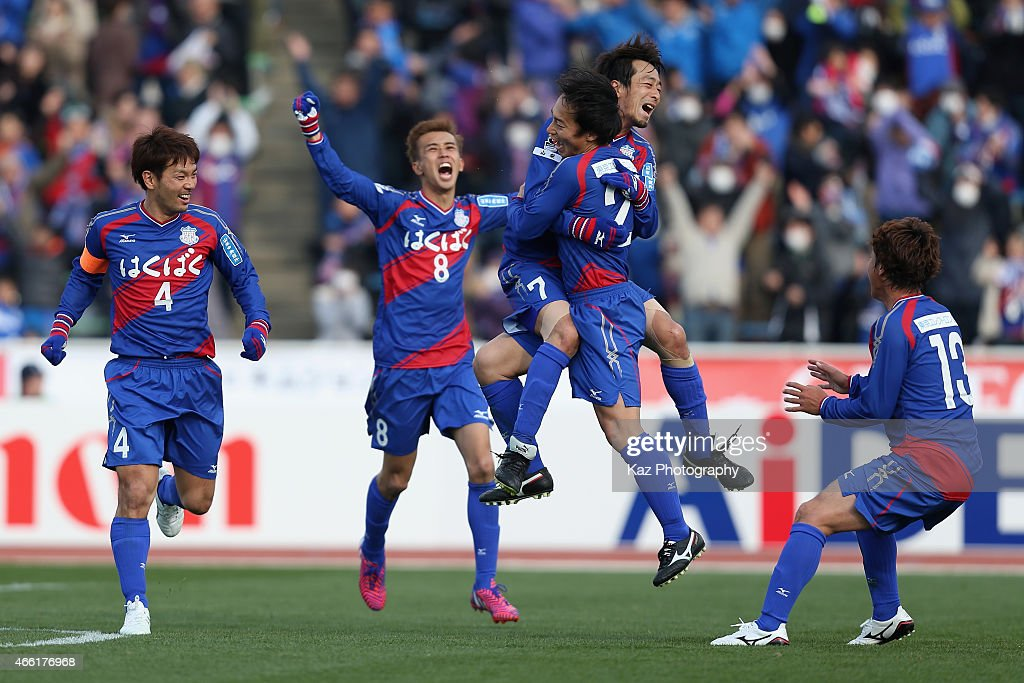 Shohei Abe of Ventforet Kofu celebrates scoring his team's first goal with his teammates during the JLeague match between Ventforet Kofu and Nagoya...