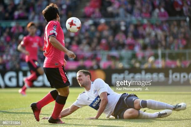 Shohei Kiyoharaof Cerezo Osaka and Milos Degenek of Yokohama FMarinos compete for the ball during the JLeague J1 match between Cerezo Osaka and...
