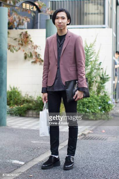 Shohei Masuya wearing a Lad Musician purple jacket and black shirt HM skinny black jeans Lad Musician leather black shoes and a Givenchy Madonna...