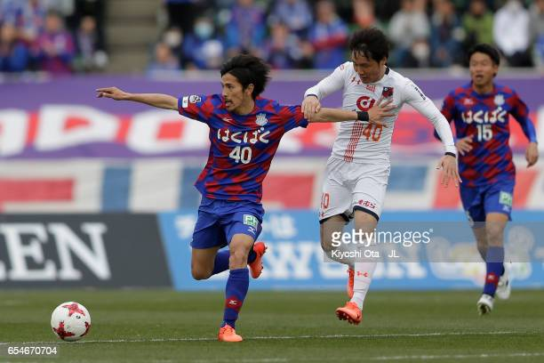 Shohei Ogura of Ventforet Kofu and Akimi Barada of Omiya Ardija compete for the ball during the JLeague J1 match between Ventforet Kofu and Omiya...