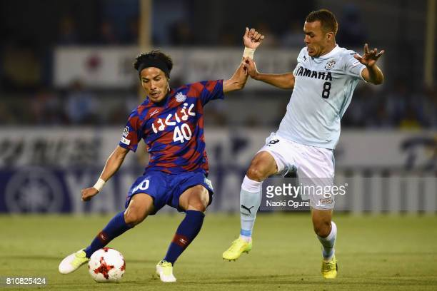 Shohei Ogura of Ventforet Kofu and Fozil Musaev of Jubilo Iwata compete for the ball during the JLeague J1 match between Jubilo Iwata and Ventforet...