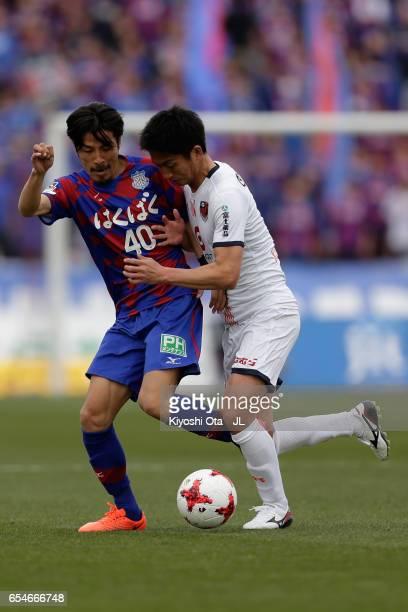 Shohei Ogura of Ventforet Kofu and Hiroyuki Komoto of Omiya Ardija compete for the ball during the JLeague J1 match between Ventforet Kofu and Omiya...