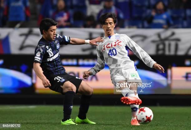 Shohei Ogura of Ventforet Kofu and Ritsu Doan of Gamba Osaka compete for the ball during the JLeague J1 match between Gamba Osaka and Ventforet Kofu...