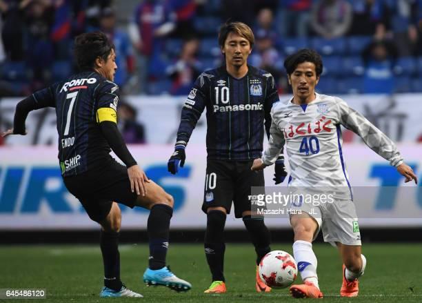 Shohei Ogura of Ventforet Kofu and Yasuhito Endo of Gamba Osaka compete for the ball during the JLeague J1 match between Gamba Osaka and Ventforet...